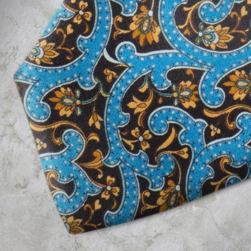 Cravatta fantasia floreale azzurra, nera, gialla SS16