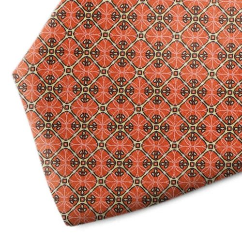 Orange and gold patterned silk tie